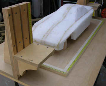 Foam model set on table with angle brackets ready for clay.