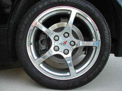 Wheel and tire of the Chevy Corvette, polished aluminum.