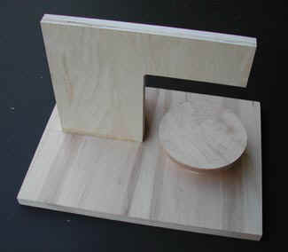 Photograph of finished spinning jig ready for turning small clay buttons, wheels or rims.