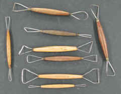 Selection of wire tools used in automotive sculpting.